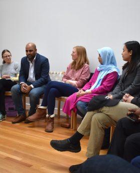Interreligious group discussing their worldviews through study of Faith in the Neighborhood